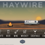 Haywire's Home Screen screen shot with 6 categories lined up a the bottom including spirits, beer, wine, whiskey, cocktails, and cigars with a background image of an all silver metal camper and an actual moving fire with the sun setting behind mountains in the background